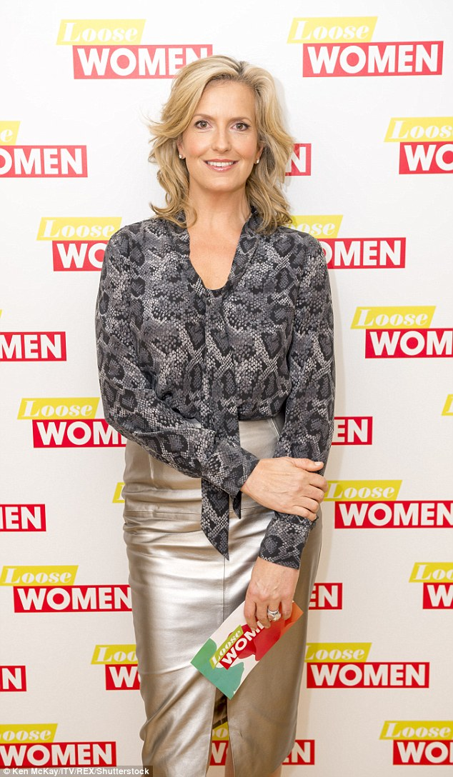 Wow thing: Penny looked incredible in a snakeskin shirt worn with a metallic pencil skirt
