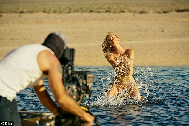 Splashing around: Charlize Theron put on a very glamorous display as she filmed a new campaign ad for J'Adore Dior perfume