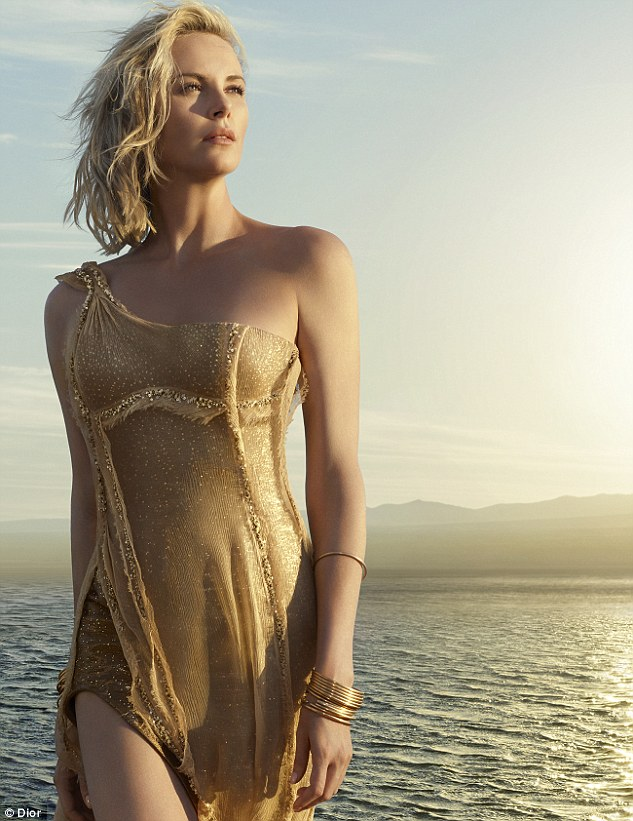 How does she do it? The 41-year-old was seen frolicking in the water, wearing a soaking wet golden gown which had two extreme thigh-splits at the front