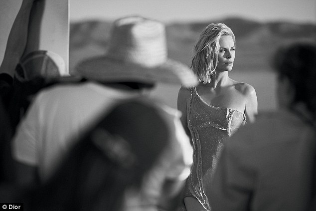 Tousled talent: Charlize looked incredible in further black and white stills