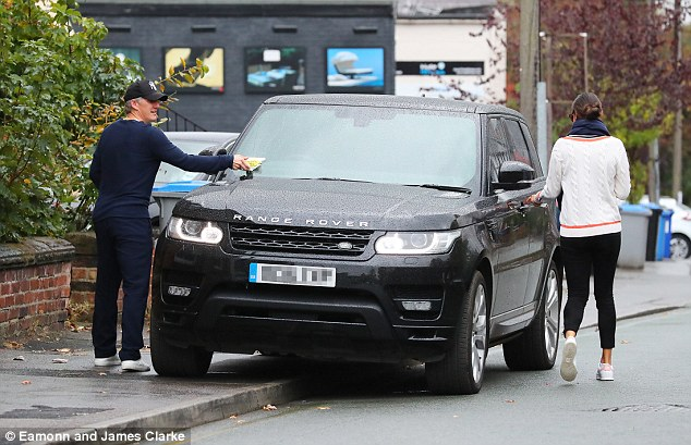 Picking up the bill: They left their black Range Rover parked on the curbside and returned to find a parking ticket on the windscreen