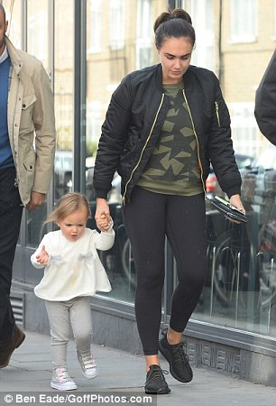 Mum's in charge: Tamara looked casual in a green crew neck sweater and black leggings as she held her young daughter¿s hand while making their way across the busy high street