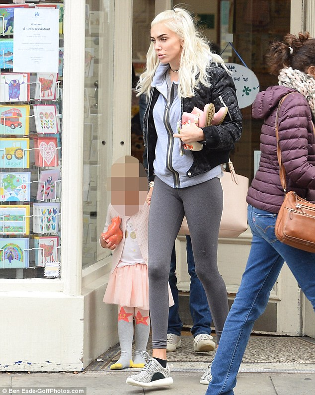 Keeping it simple: The Los Angeles based blonde looked relaxed in a grey hooded top and matching legging