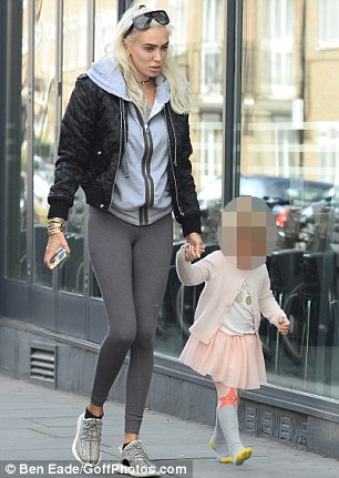 It's a match: The Los Angeles based blonde looked equally relaxed in a grey hooded top and matching leggings as she walked alongside her sister