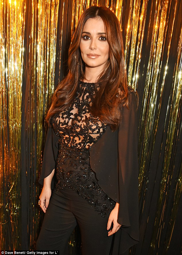 Glowing: Cheryl was positively glowing during her most recent red carpet appearance - here at a Paris Fashion Week party 10 days ago - amid claims that she is pregnant