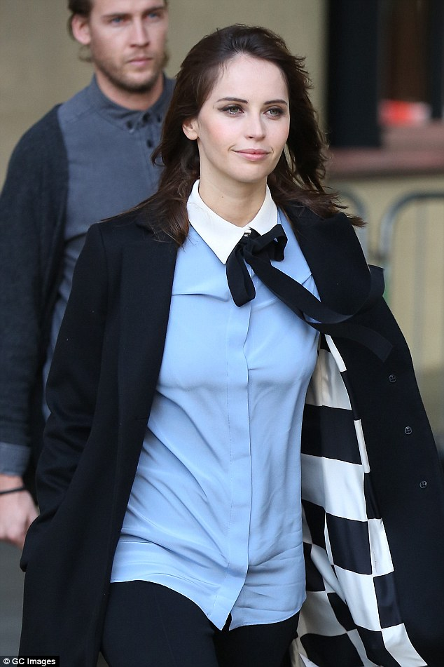 Chic: She dressed in a sophisticated pussybow blouse for the occasion