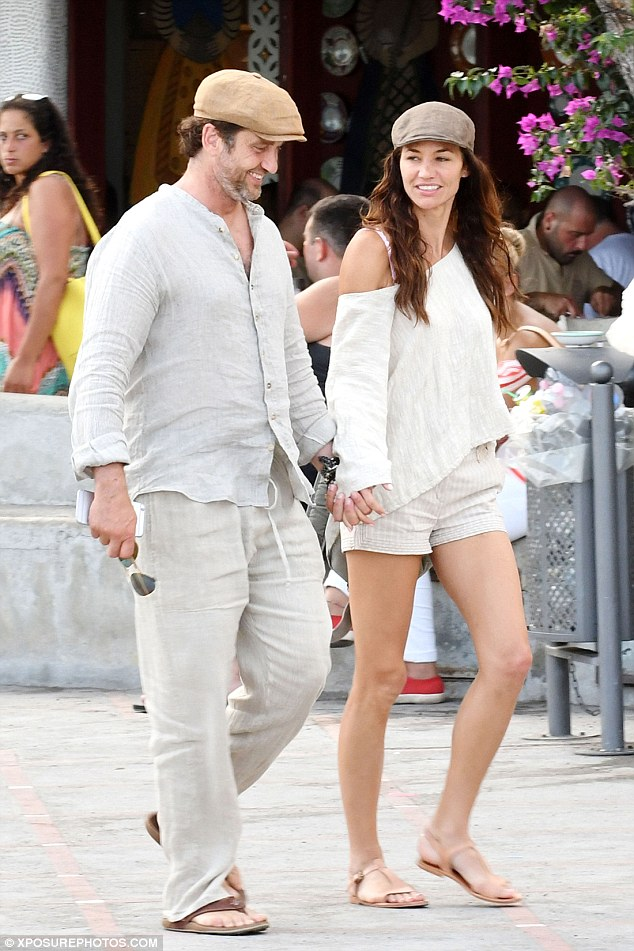 In love: Gerard has been dating model girlfriend Morgan Brown since May 2014 (pictured together in Positano, Italy, in July)