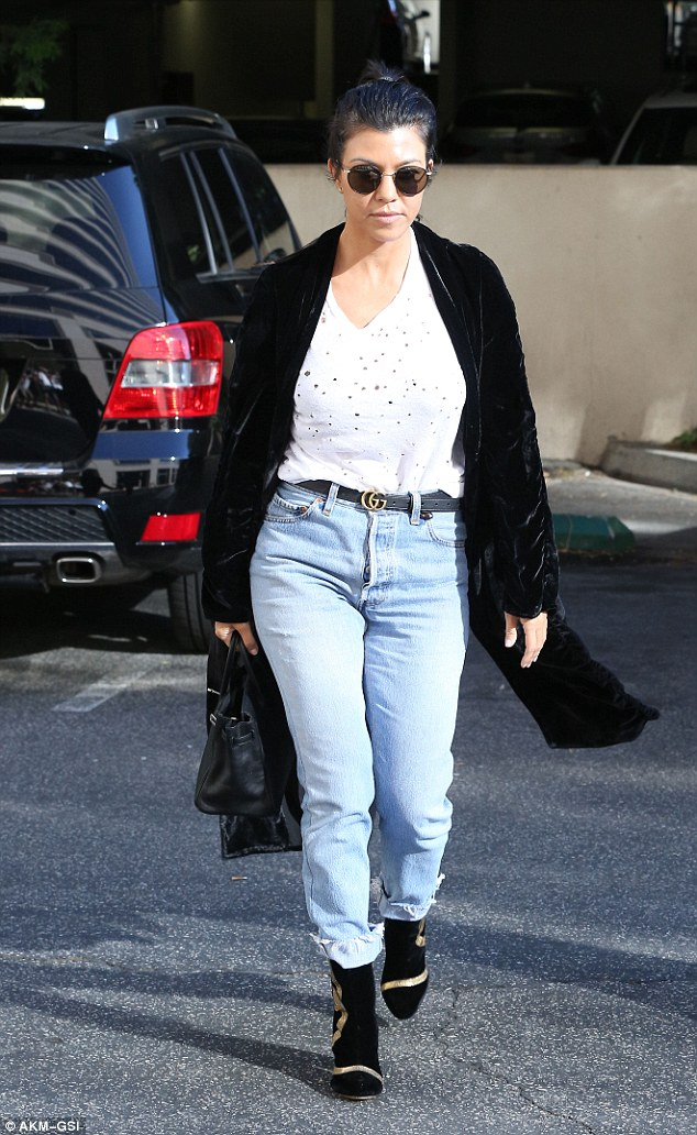 Still recovering:Kourtney Kardashian looked sad as she stepped out for a meeting in Woodland Hills on Tuesday