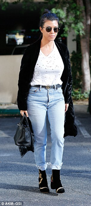 Meeting ready:The reality star added a Gucci belt and a pair of chic boots to her casual look