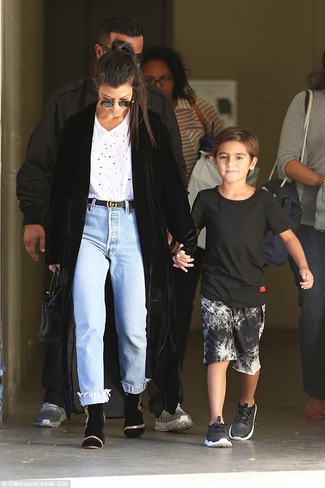 Her little guy: The E! beauty held the hand of her oldest child Mason