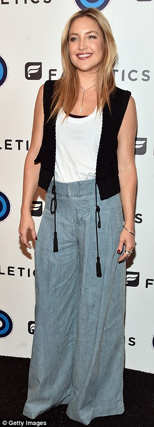 Flower power:As if that was not enough Seventies flare, she also wore a pair of large flowy bell-bottomed jeans