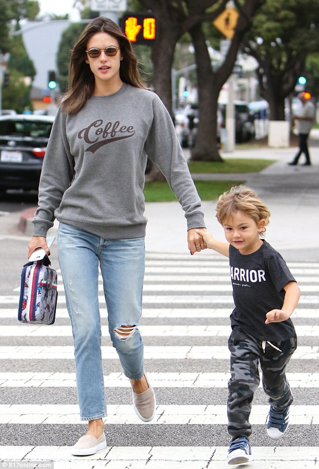 Bonding time: Alessandra Ambrosio was spottedtrying to keep pace with her four-year-old son Noah while out and about in Los Angeles on Tuesday