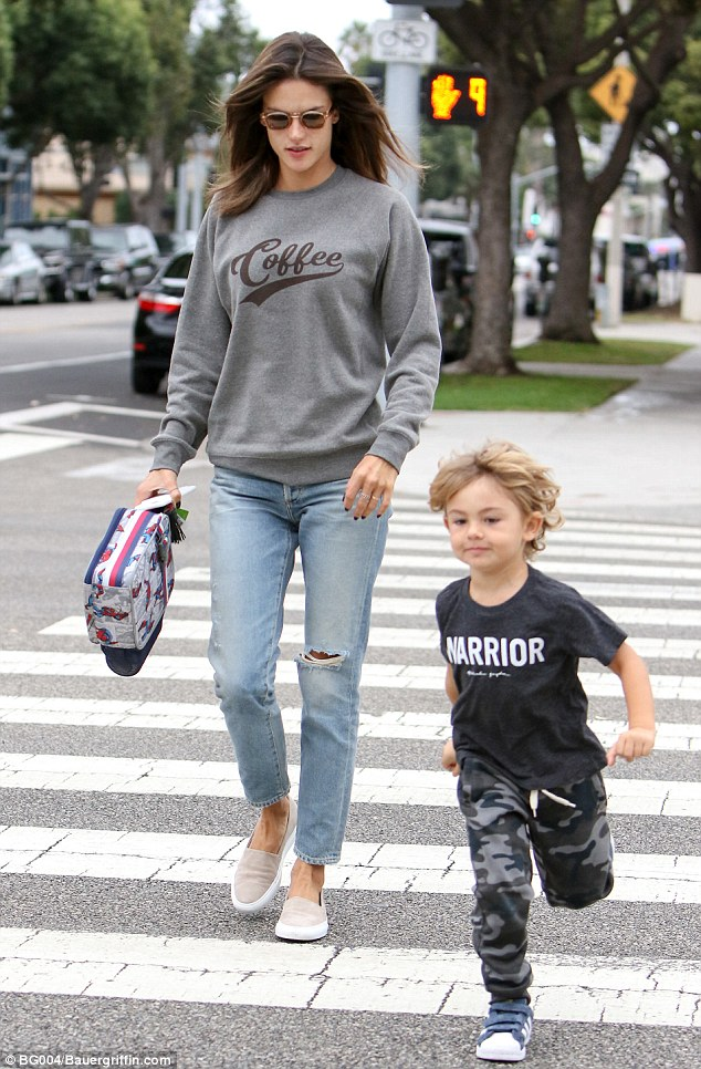 Full of energy: The 35-year-old model followed closely behind her youngest son