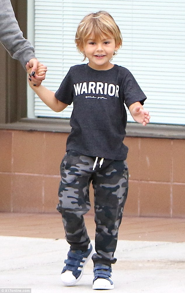 Joyful:Noah also had a message on his shirt as the dark grey top read 'Warrior' along with camouflage joggers and Adidas trainers
