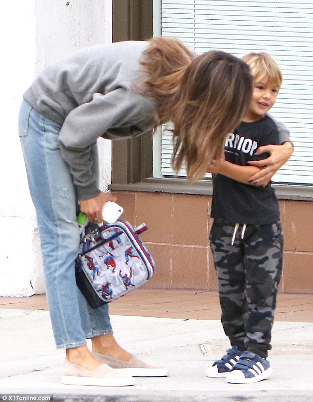 Motherly love: Alessandra gave her son a loving kiss on the cheek