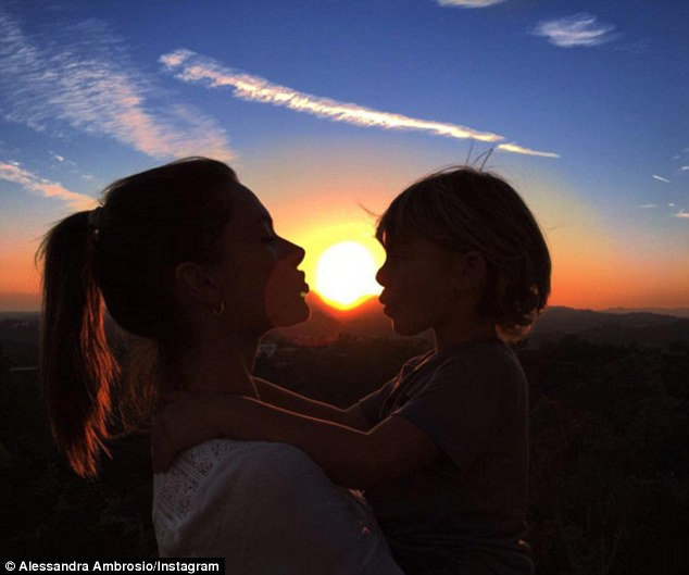 Reunited: The Victoria's Secret Angel recently globetrotted for her modelling career and recently posted this photo with her young son after returning home
