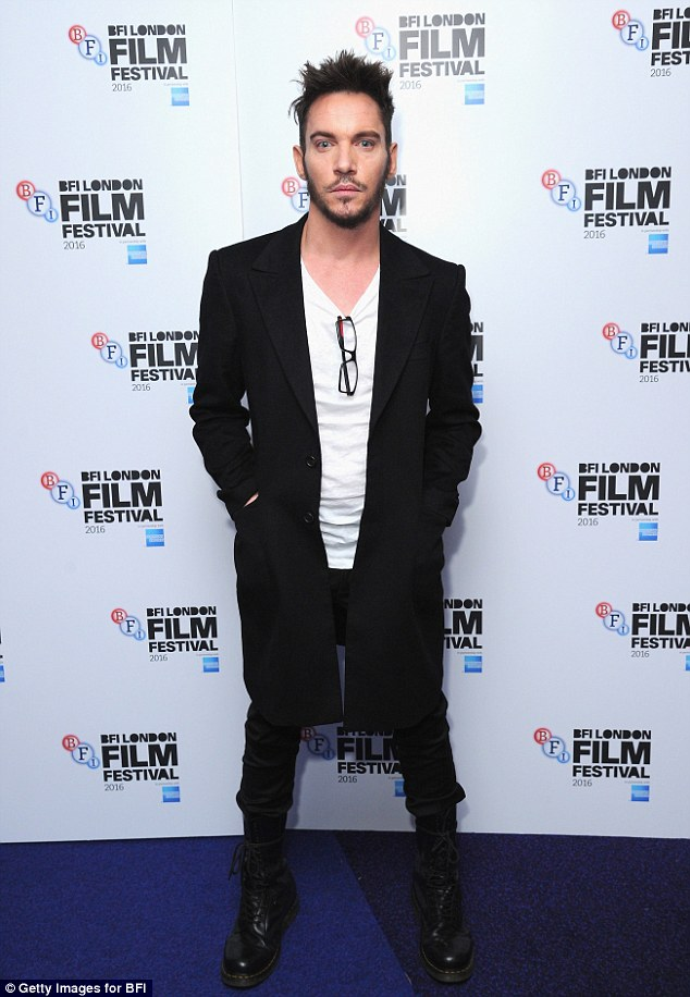 Smouldering: Jonathan Rhys Meyers proved exactly why as he stormed the red carpet at the screen of his latest movie London Town in the capital on Tuesday night during the BFI Festival