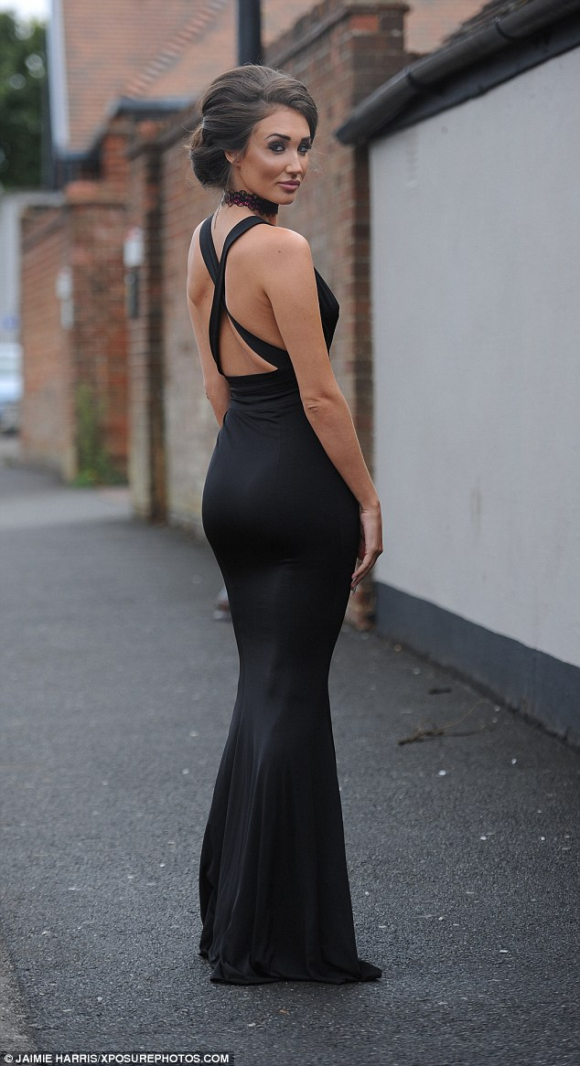 Glamorous: The brunette beauty, 24, ensured she looked her very best for the occasion, donning a daring black dress with an extreme plunging neckline