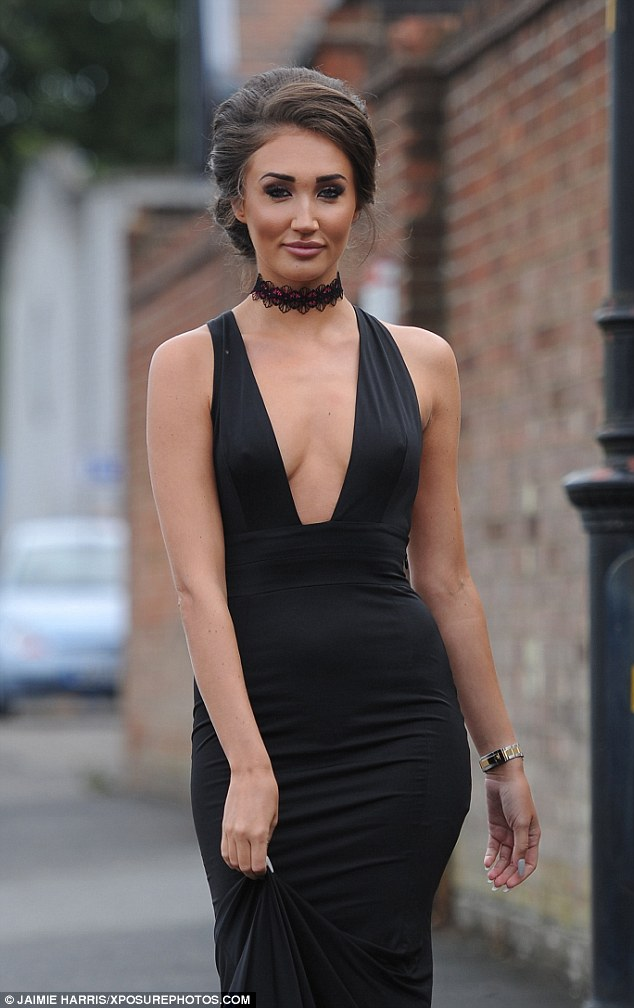 Done up to perfection: Ever the glamourpuss, Megan opted for a full face of make-up and a voluminous, hairspray heavy updo