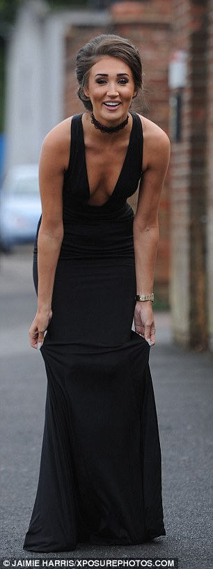 Perfection from head-to-toe: Megan completed her eveningwear look with a pair of simple black heels