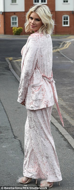 Boudoir chic: Chloe was rocking a velour, pyjama style ensemble complete with fluffy heels