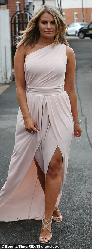 Simple yet chic: Danielle Armstrong wowed in a pale silk gown in a one shoulder style