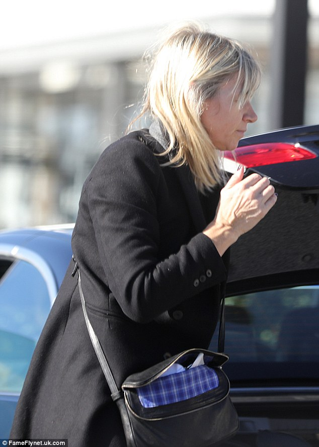 In a rush: The mother-of-two climbed into her car following her visit to the shops
