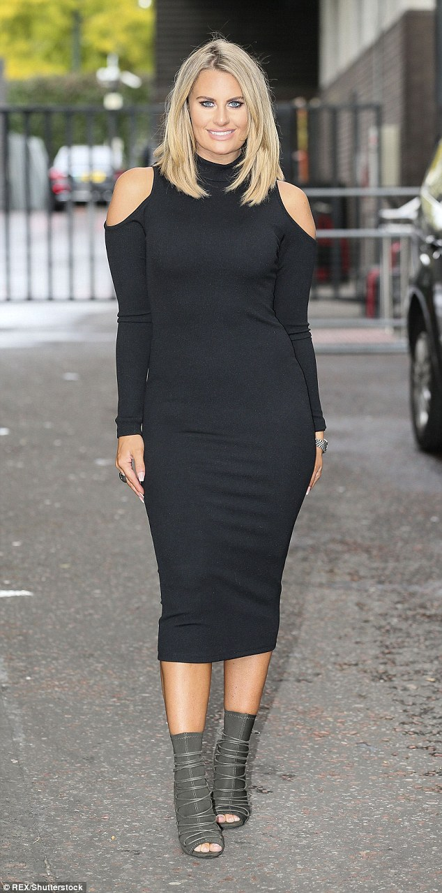 Simple yet stylish: Danielle donned a black bodycon dress in a cold shoulder style