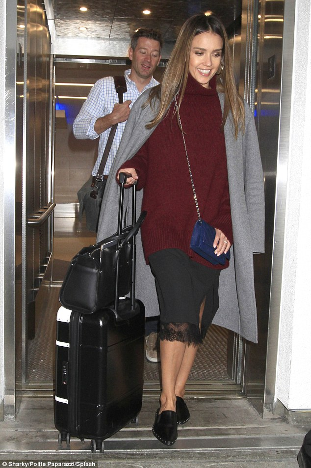 Jet-setter: Jessica Alba looked glamorous as she touched down at Los Angeles' LAX airport  on Tuesday night