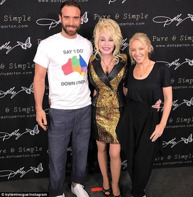 Standing up for what he believes in: Joshua has started his Say I Do Down Under campaign to try and legalise same-sex marriage (seen with Kylie and Dolly Parton)