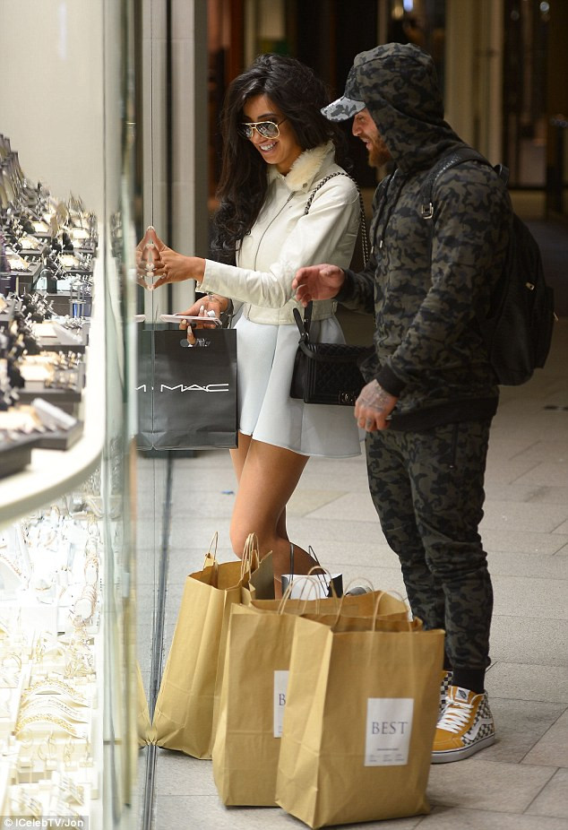 Taking the next step? Chloe Khan, 25, and Ashley Cain's romance appeared to be on fast forward as the flirty pair were spotted ring shopping in Leeds city centre on Thursday