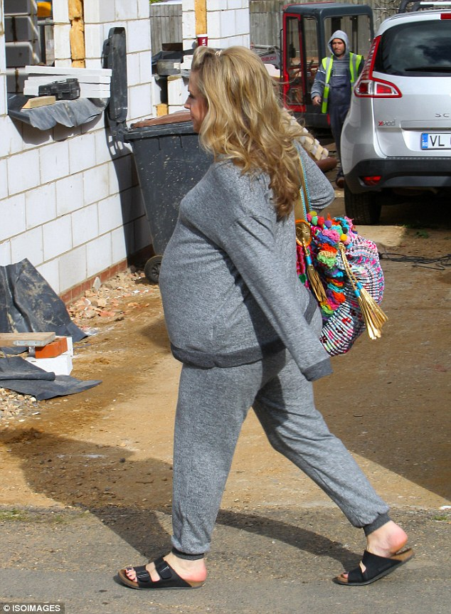 Casual vibe: Kellie's two-piece leisure wear was set off with black sandals and a funky pom pom embellished handbag