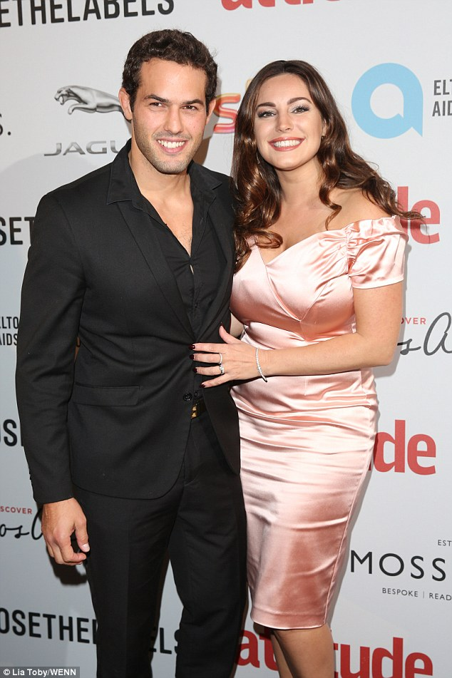 Loved-up:Kelly Brook was ready to party alongside her handsome beau Jeremy Parisi