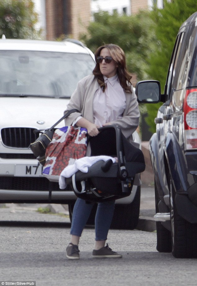 Doting mum: Natalie Cassidy, 33, enjoyed a day out shopping in London with her youngest, Joanie Elizabeth, two months, on Wednesday
