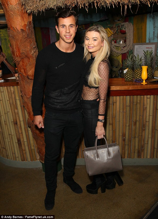 Strike a pose:Georgia arrived at the bash with a mystery man