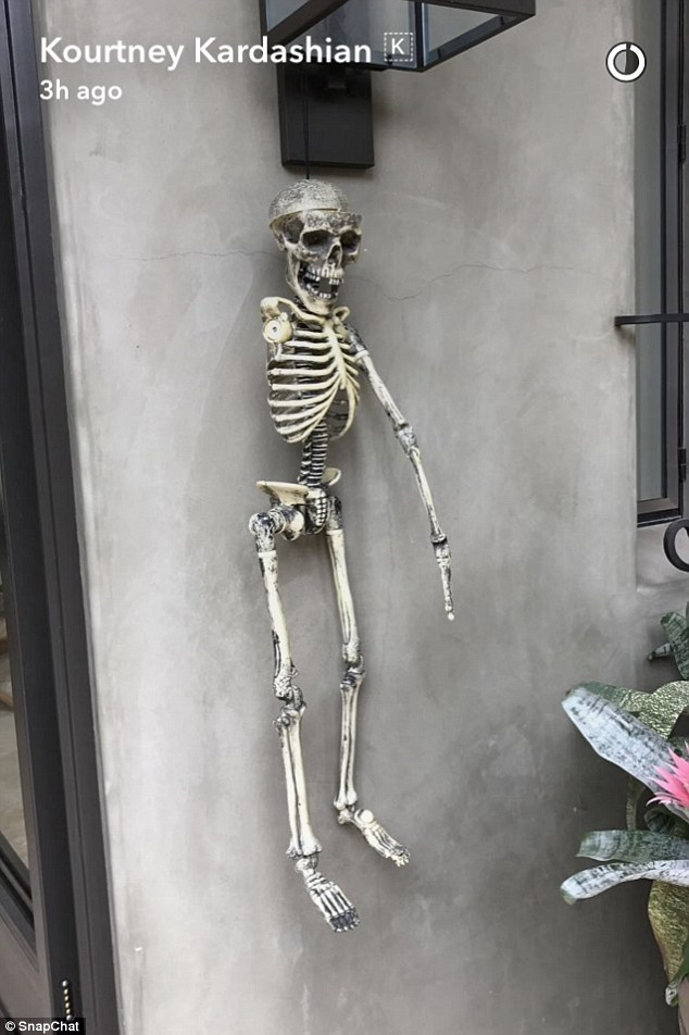Creepy: She also shared a picture of a skeleton hanging on the wall with one arm missing