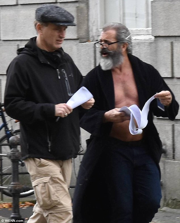 Bare chested: Mel Gibson bared his chest as he strolled through the Dublin set of his latest film The Professor and the Madman on Tuesday