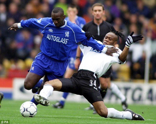 Ram raider: West (right) challenges Jimmy-Floyd Hasselbaink while playing in the Premier League for Derby County