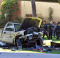Police stand near the pickup truck that landed at Chicano Park after it flew off a ramp to the San Diego Coronado Bridge in San Diego on Saturday, Oct. 15, 2016.  Four people were killed and nine were injured on Saturday after an out-of-control pickup truck plunged off the San Diego-Coronado Bridge and plowed into crowd gathered at a festival below, authorities said.   (Hayne Palmour IV/The San Diego Union-Tribune via AP)