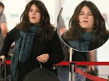 """Caption: EXCLUSIVE: **PREMIUM EXCLUSIVE RATES APPLY**Monica Lewinsky is seen for the first time since the Donald Trump sexual assault claims via an old """"Access Hollywood"""" video.  The former White House intern & current activist was seen flying out of LAX.  Lewinsky hasn't changed a bit as she's dressed in blue jeans, leopard print Vans & a black sweater with a green scarf."""