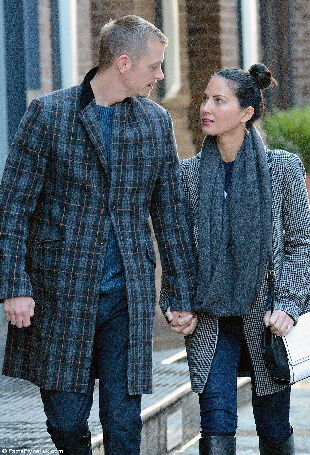 Locking eyes: Olivia and her boyfriend Joel Kinnaman, 34, both gazed into each others eyes in New York City on Friday