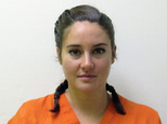 FILE - This October 2016 file photo provided by the Morton County Sheriff's Department in Mandan, N.D., shows actress Shailene Woodley who was arrested Monday, Oct. 10, 2016, during a protest against the Dakota Access pipeline. Woodley is to stand trial in North Dakota in early 2017 on charges related to her protest. (Morton County Sheriff's Department via AP)