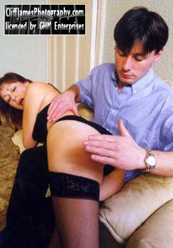 Barbara gets an OTK spanking from Nick Baker in the Harrison Marks Kane video Squatter%27s Rights