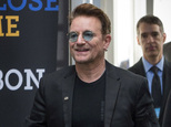 FILE - In this Sept. 17, 2016 file photo, Bono arrives at the Global Fund conference in Montreal. Bono will be honored as Glamour magazine's first Man of the Year among the magazine's Women of the Year recipients, on Nov. 14 in Los Angeles. (Paul Chiasson/The Canadian Press via AP, File)