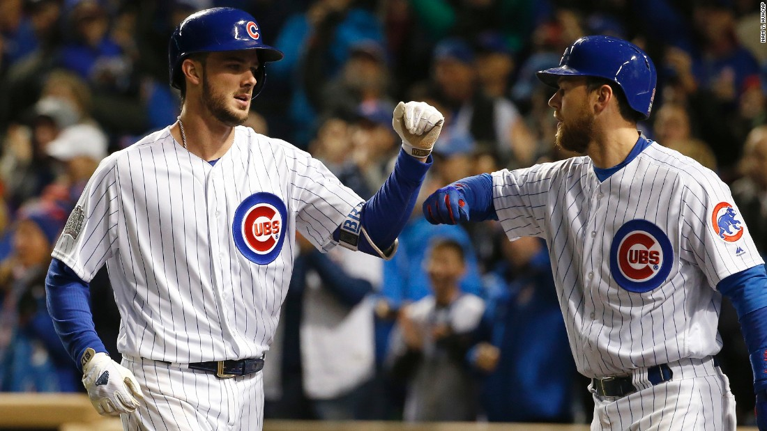 The Cubs' Kris Bryant, left, celebrates with Ben Zobrist after hitting a home run during the fourth inning of Game 5.