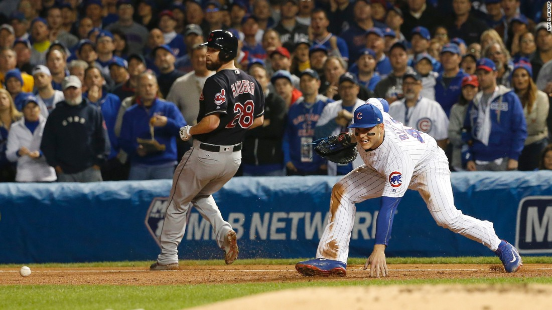 Cleveland's Corey Kluber is safe at first as Cubs first baseman Anthony Rizzo can't make a play on a wild throw by third baseman Kris Bryant during the second inning of Game 4.