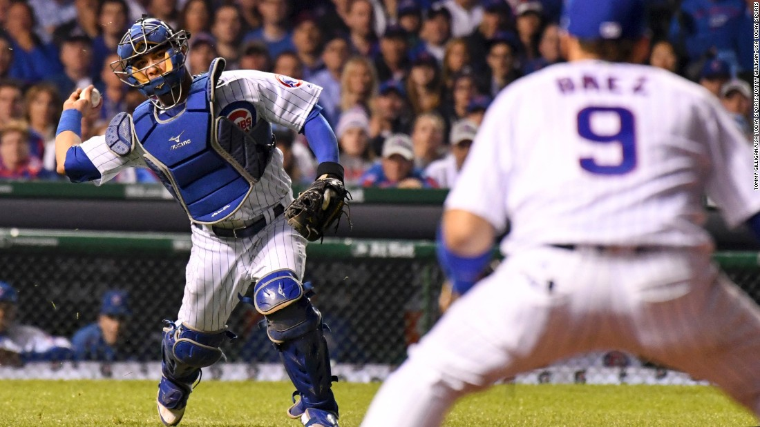 Willson Contreras of the Cubs throws to second baseman Javier Baez for an out on a bunt attempt by Indians starting pitcher Josh Tomlin in Game 3.