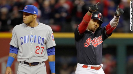 Jose Ramirez of the Cleveland Indians reacts after hitting a double during the sixth inning as Addison Russell of the Chicago Cubs looks on in Game One of the 2016 World Series at Progressive Field on October 25, 2016 in Cleveland, Ohio.