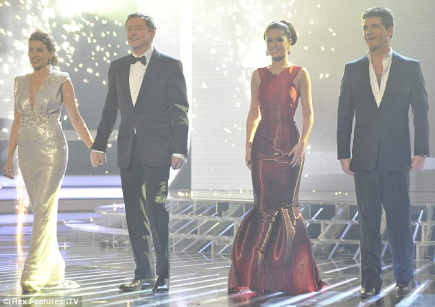 Let the battle commence: The X Factor judges arrive on to the stage at the start of the final