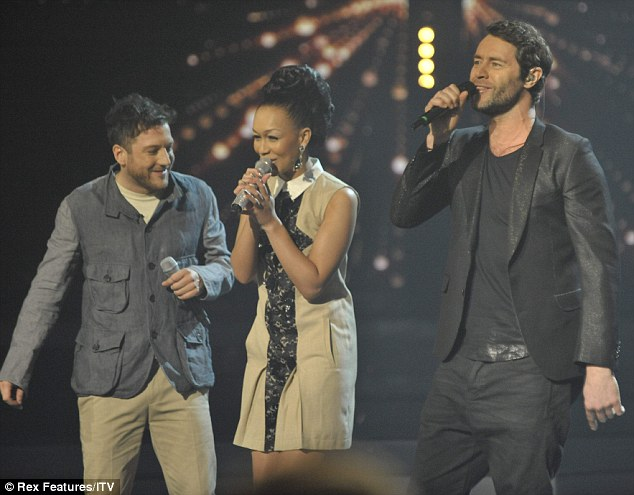 Crowd pleaser: To open the show the three finalists performed with Take That as they sang Never Forget ensemble